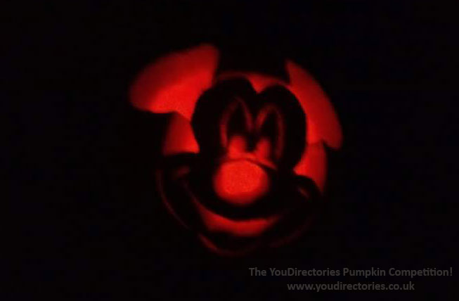 Lucy and her son Tyler are missing Disney and carved a Mickey Mouse Pumpkin