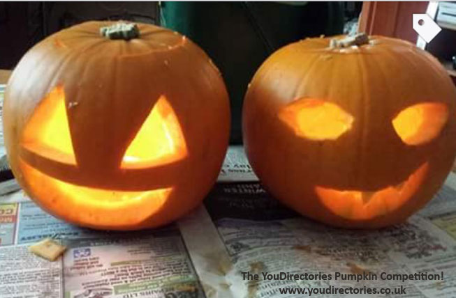 Simple yet slightly sinister pair of pumpkins from Laura B